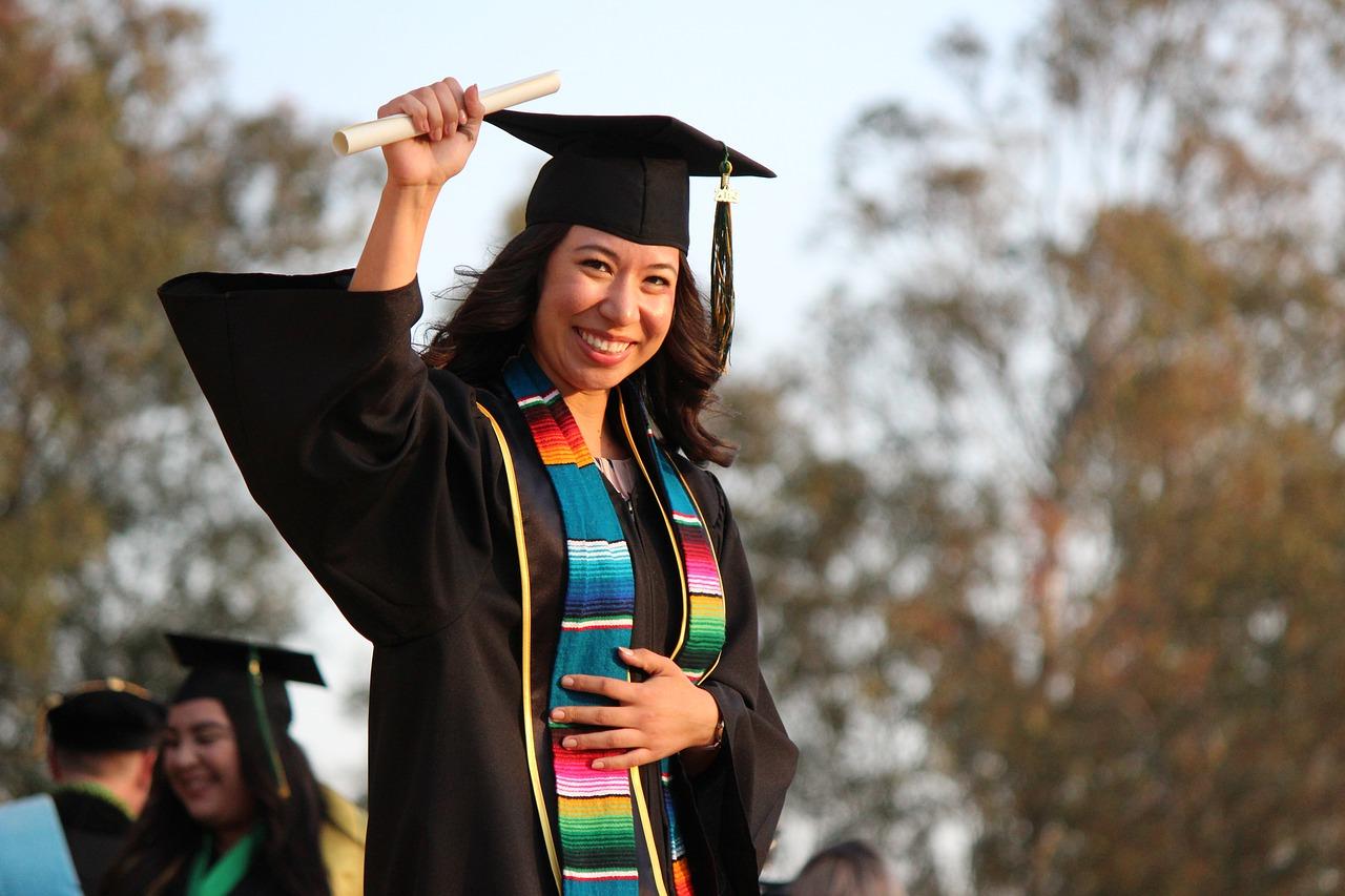 Woman graduating with an Associate's degree
